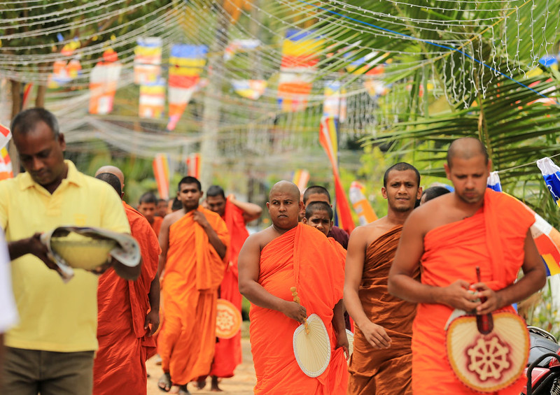 . Sri Lankan Buddhist monks arrive for the alms giving ceremony for remembrance and prayer for the victims of the 2004 Boxing Day tsunami on December 26, 2014 in Peraliya, Sri Lanka. Sri Lanka was one of the worst hit countries of the 9.1 magnitude quake with around 35,000 deaths. Throughout the affected region of eleven countries, nearly 230,000 people were killed, making it one of the deadliest natural disasters in recorded history.  (Photo by Buddhika Weerasinghe/Getty Images)