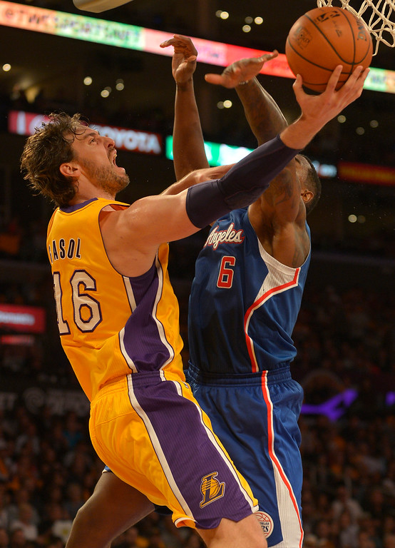 . Lakers#16 Pau Gasol goes up against Clippers#6 DeAndre Jordan in the 4th quarter. The Los Angeles Lakers defeated the Clippers 116 to 103 in the opening game of the season at Staples Center. Los Angeles, CA. 10/29/2013. photo by (John McCoy/Los Angeles Daily News)