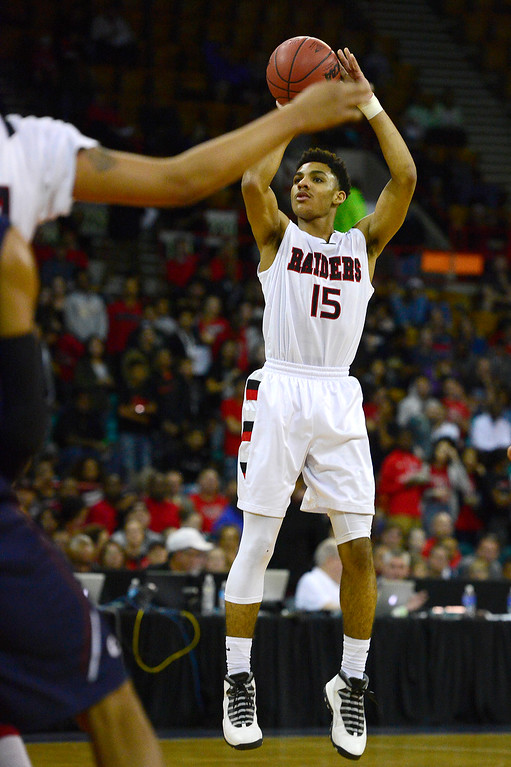 . Rangeview guard Elijah Blake (15) shoots a three during the first half at the Denver Coliseum on March 5, 2016 in Denver, Colorado. Rangeview defeated Cherokee Trail 75-64 to advance to the semifinals in the Class 5A Colorado state basketball tournament. (Photo by Brent Lewis/The Denver Post)