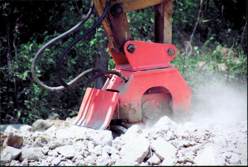 NPK C6C compactor with backfill blade on Deere excavator at NPKCE (2).JPG