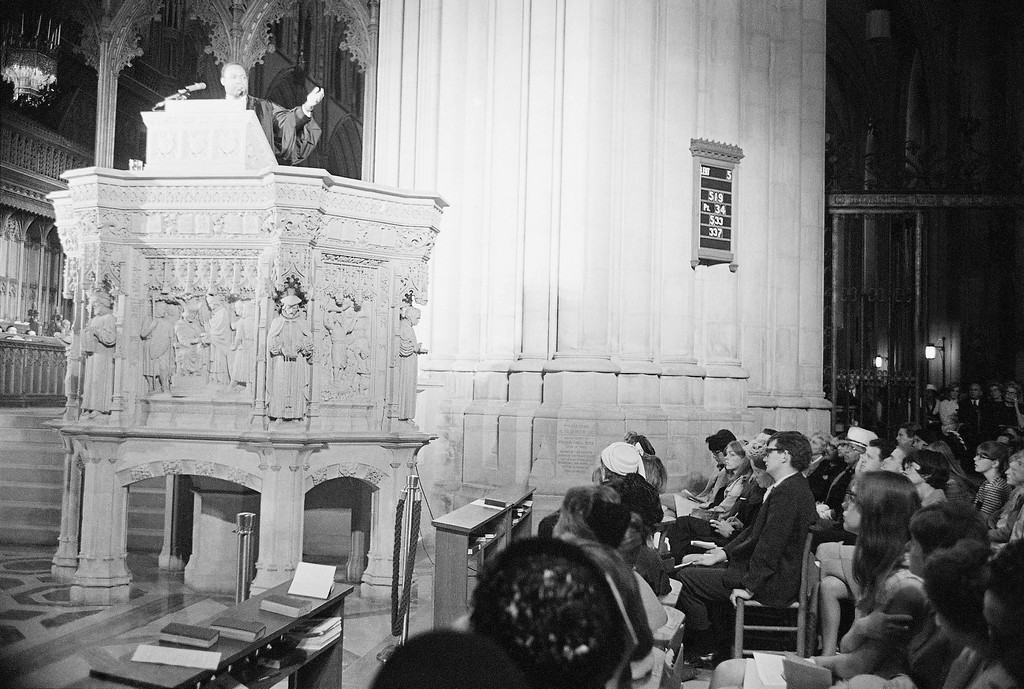 ". Dr. Martin Luther King, left, who heads the Southern Christian Leadership Conference, addresses a capacity crowd from the pulpit at the National Cathedral in Washington, D.C., March 31, 1968. Discussing his proposed demonstrations at the capital, tentatively set for June 15, Dr. King said ""We\'re not coming to tear Washington apart. We\'re coming to demand to know if the government will address itself to the problems of poverty."" (AP Photo/John Rous)"