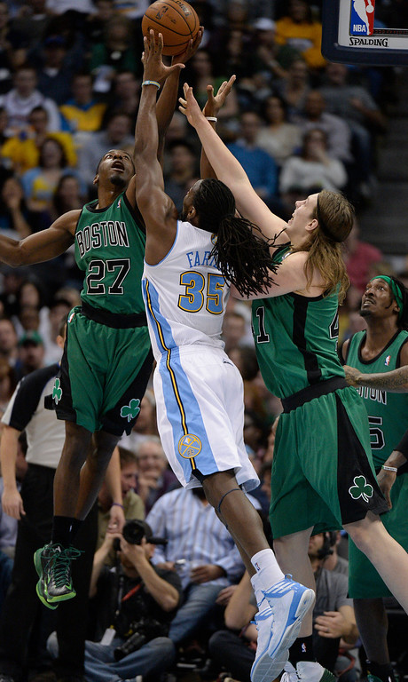 . Boston Celtics shooting guard Jordan Crawford (27) and Boston Celtics center Kelly Olynyk (41) battle for a rebound with Denver Nuggets power forward Kenneth Faried (35) during the third quarter January 7, 2014 at Pepsi Center. (Photo by John Leyba/The Denver Post)