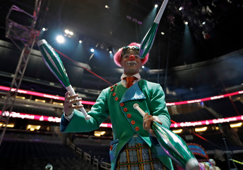 ". A Ringling Bros. and Barnum & Bailey clown juggles for fans during a pre show Saturday, Jan. 14, 2017, in Orlando, Fla. The Ringling Bros. and Barnum & Bailey Circus will end the ""The Greatest Show on Earth\"" in May, following a 146-year run of performances. Kenneth Feld, the chairman and CEO of Feld Entertainment, which owns the circus, told The Associated Press, declining attendance combined with high operating costs are among the reasons for closing. (AP Photo/Chris O\'Meara)"