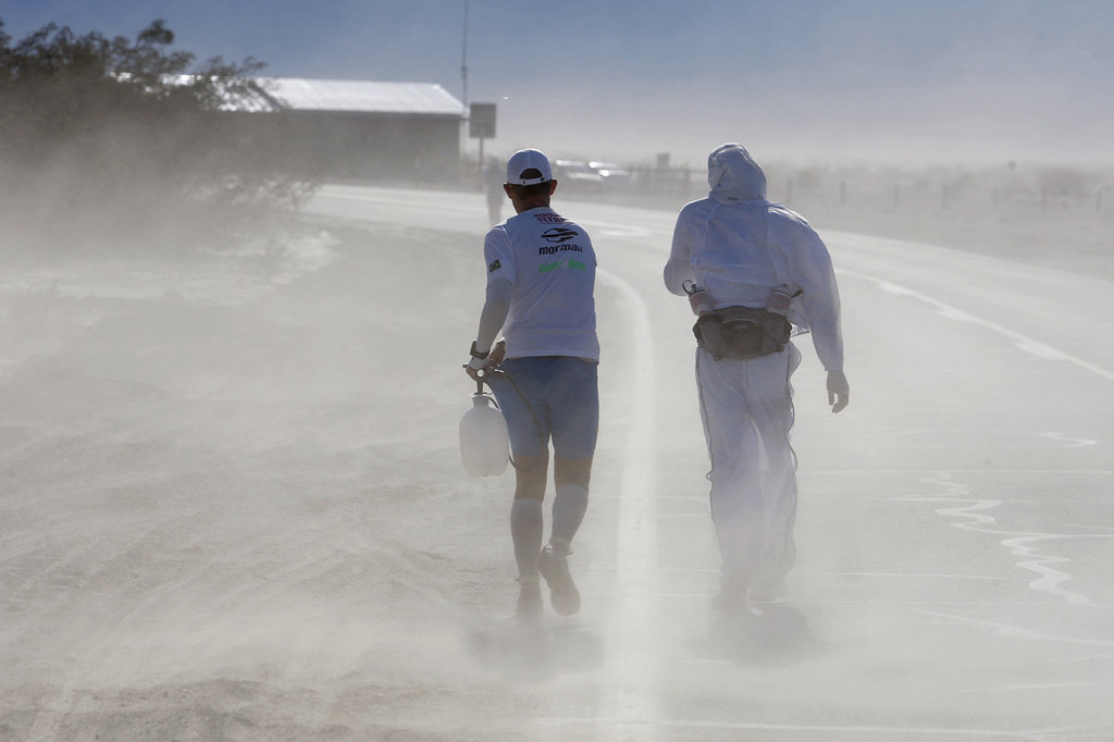 . A crew member carrying a water spray bottle and a runner endure blowing dust in strong winds near Stovepipe Wells during the AdventurCORPS Badwater 135 ultra-marathon race on July 15, 2013 in Death Valley National Park, California. Billed as the toughest footrace in the world, the 36th annual Badwater 135 starts at Badwater Basin in Death Valley, 280 feet below sea level, where athletes begin a 135-mile non-stop run over three mountain ranges in extreme mid-summer desert heat to finish at 8,350-foot near Mount Whitney for a total cumulative vertical ascent of 13,000 feet. July 10 marked the 100-year anniversary of the all-time hottest world record temperature of 134 degrees, set in Death Valley where the average high in July is 116. A total of 96 competitors from 22 nations are attempting the run which equals about five back-to-back marathons. Previous winners have completed all 135 miles in slightly less than 24 hours.  (Photo by David McNew/Getty Images)