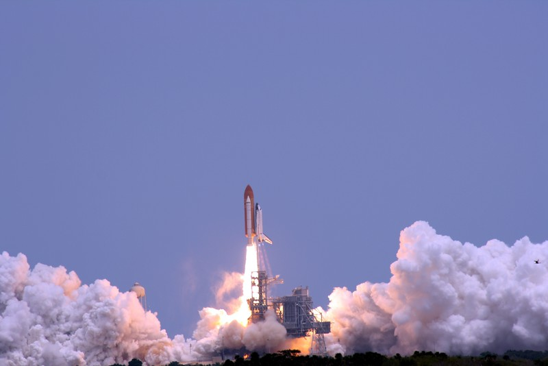 Atlantis rises from Launch Pad 39-A, T plus 4 seconds after liftoff