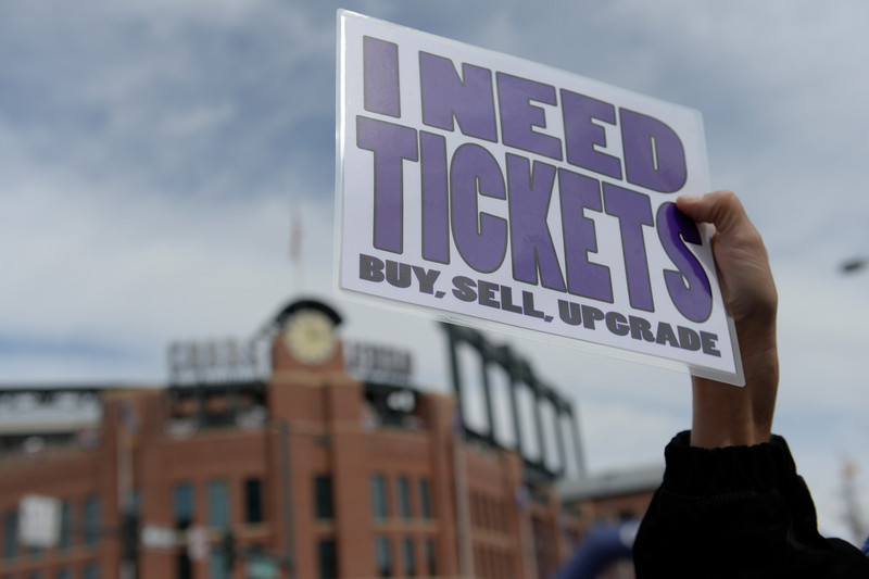 . Ticket broker David Glowczewski works the crowd outside the stadium. The Colorado Rockies hosted the Arizona Diamondbacks in the Rockies season home opener at Coors Field in Denver, Colorado Friday, April 4, 2014. (Photo by Craig F. Walker/The Denver Post)