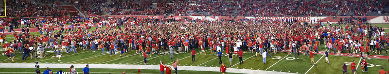 ... while the UH fans mob their team.  Chaos and Cacaphony!