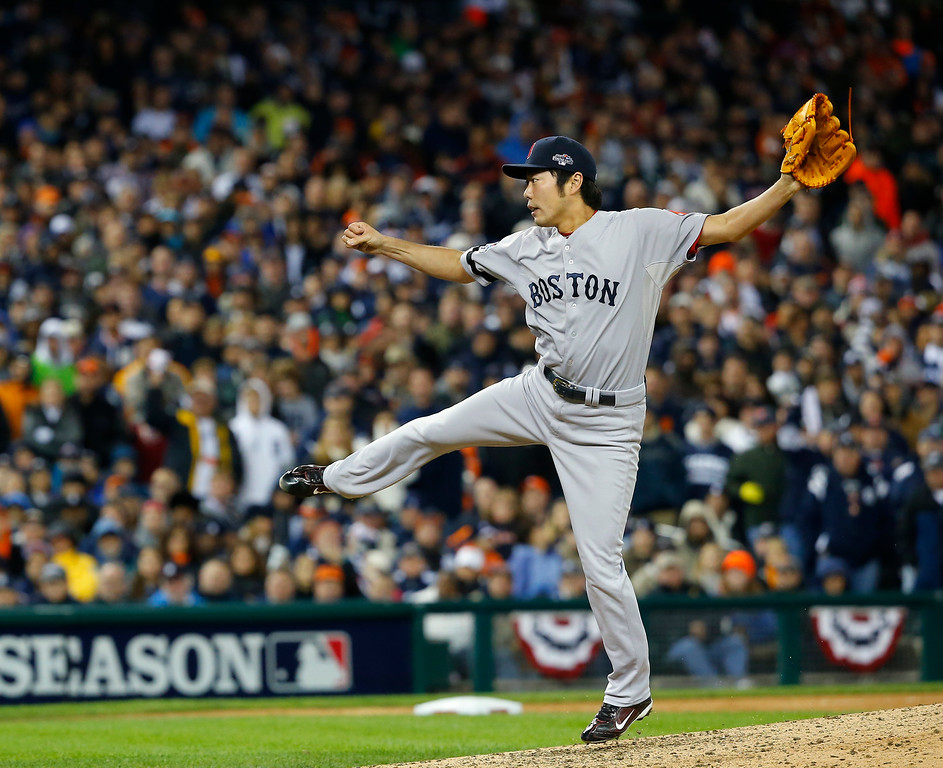 . Boston Red Sox\'s Koji Uehara throws in the eighth inning during Game 5 of the American League baseball championship series against the Detroit Tigers, Thursday, Oct. 17, 2013, in Detroit. (AP Photo/Paul Sancya)