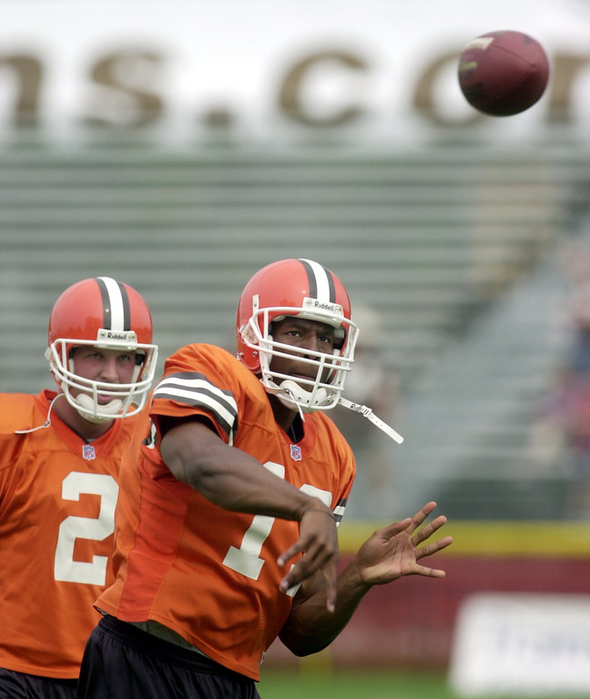 . News-Herald file Browns quarterback Spergon Wynn passes as Tim Couch watches.