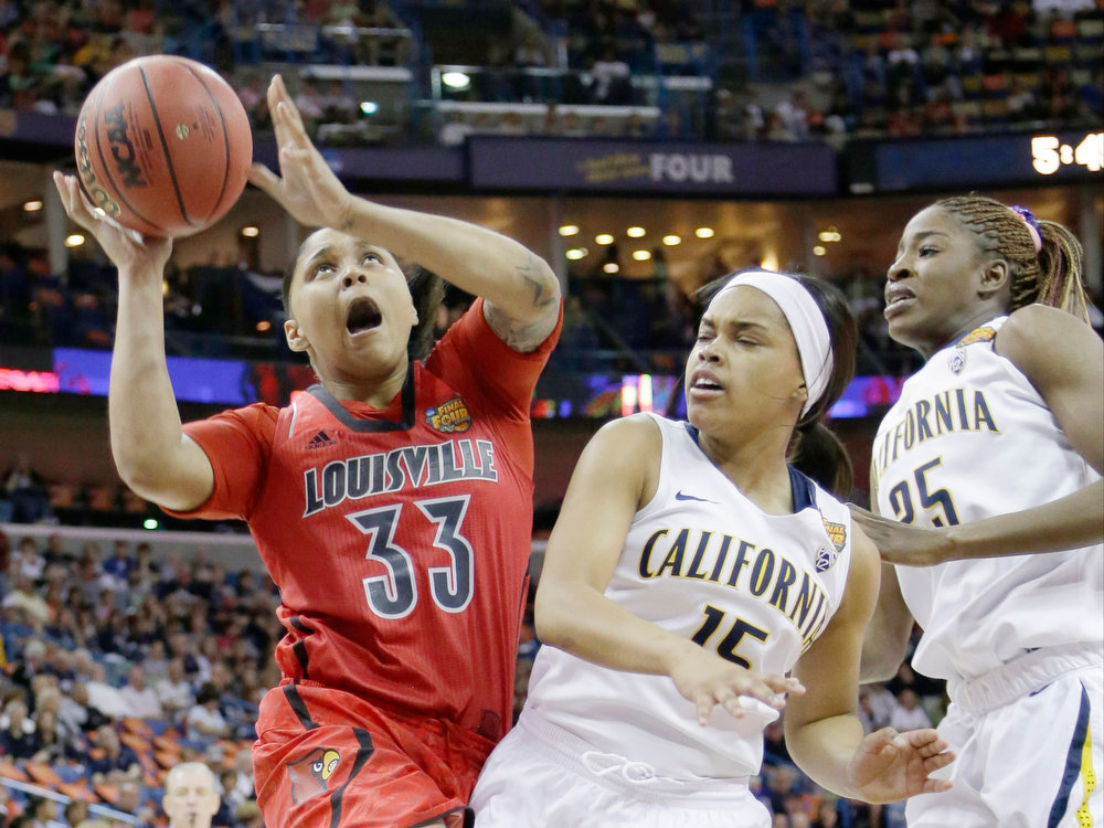 Description of . Louisville forward Monique Reid (33) goes up for a shot against California guard Brittany Boyd (15) and California forward Gennifer Brandon (25) in the first half of a national semifinal at the Women's Final Four of the NCAA college basketball tournament, Sunday, April 7, 2013, in New Orleans. (AP Photo/Gerald Herbert)