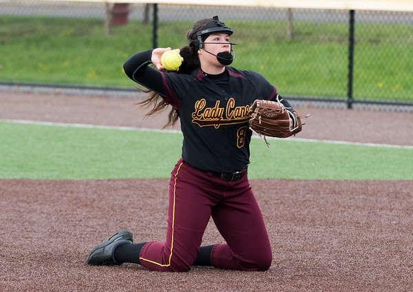 04/29/19 Wesley Bunnell | Staff New Britain softball defeated Conard at Chesley Park on Monday afternoon. Makaila Masterson (8) after droping to her knees for a tough infield catch between 1st and second base.