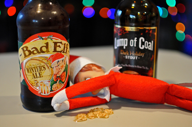 """365.25 - Ellken, the Elf on a Shelf, partied a little too hard last night...can't hold his """"Bad Elf"""" ale! Amazingly, he was gone and the counter was cleaned up within minutes of taking this picture!"""