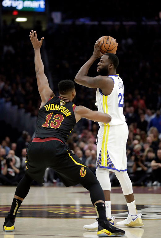 . Golden State Warriors\' Draymond Green is defended by Cleveland Cavaliers\' Tristan Thompson in the first half of Game 3 of basketball\'s NBA Finals, Wednesday, June 6, 2018, in Cleveland. (AP Photo/Tony Dejak)