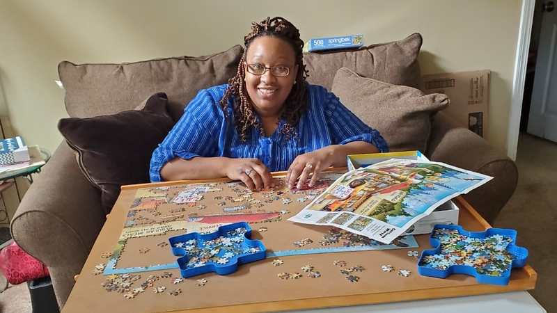 Moore works on jigsaw puzzles at home to relax.