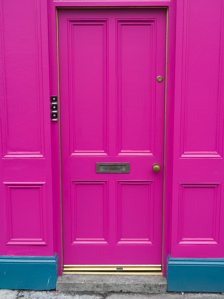Closed pink door of a house, Ennistimon, County Clare, Ireland