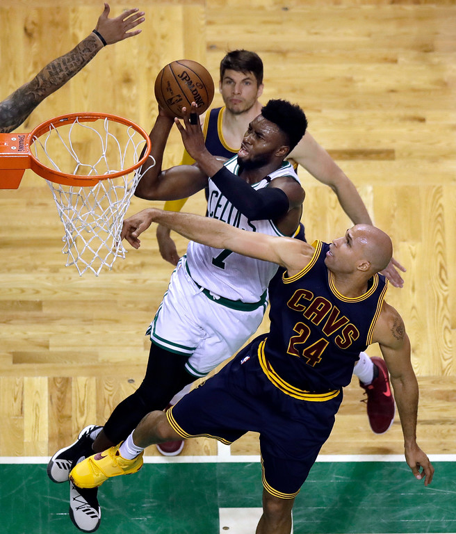 . Boston Celtics forward Jaylen Brown (7) drives past Cleveland Cavaliers forward Richard Jefferson (24) during the fourth quarter of Game 1 of the NBA basketball Eastern Conference finals, Wednesday, May 17, 2017, in Boston. (AP Photo/Charles Krupa)