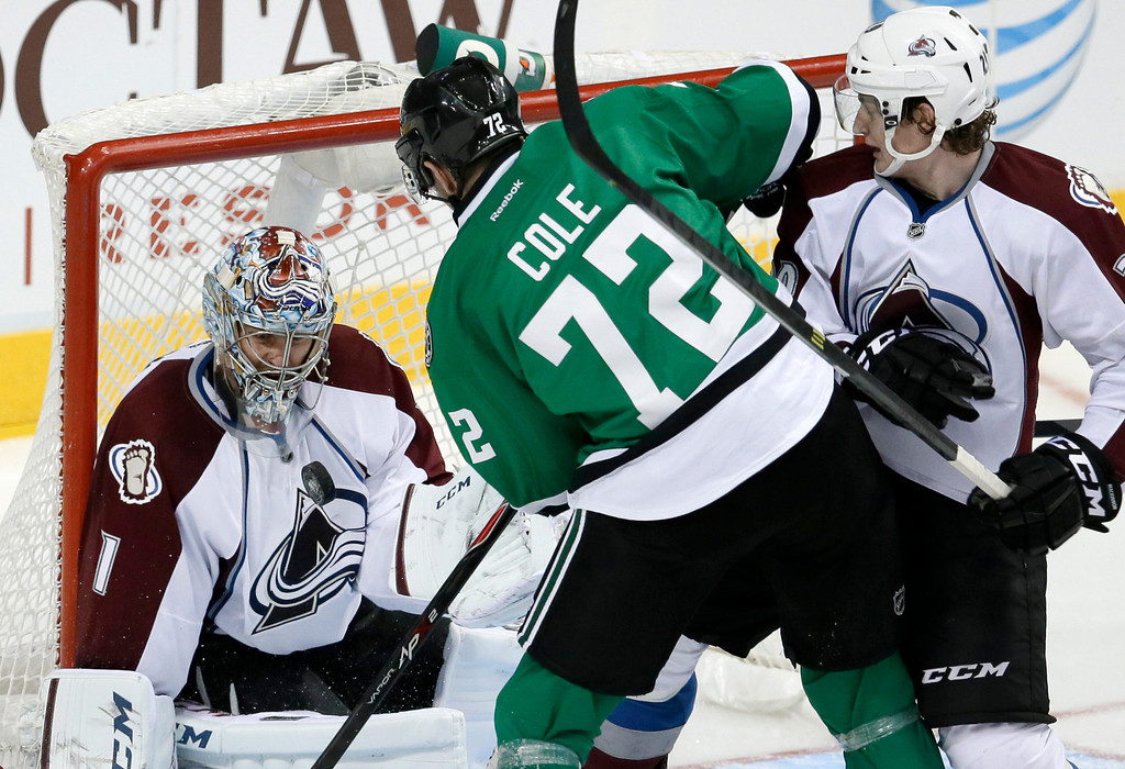 . Colorado Avalanche goalie Semyon Varlamov (1), of Russia, watches an airborne puck before gloving it in front of Dallas Stars right wing Erik Cole (72) and the Avalanche\'s Nathan MacKinnon, right, in the third period of an NHL hockey game, Friday, Nov. 1, 2013, in Dallas. The Avalanche won 3-2 in overtime. (AP Photo/Tony Gutierrez)