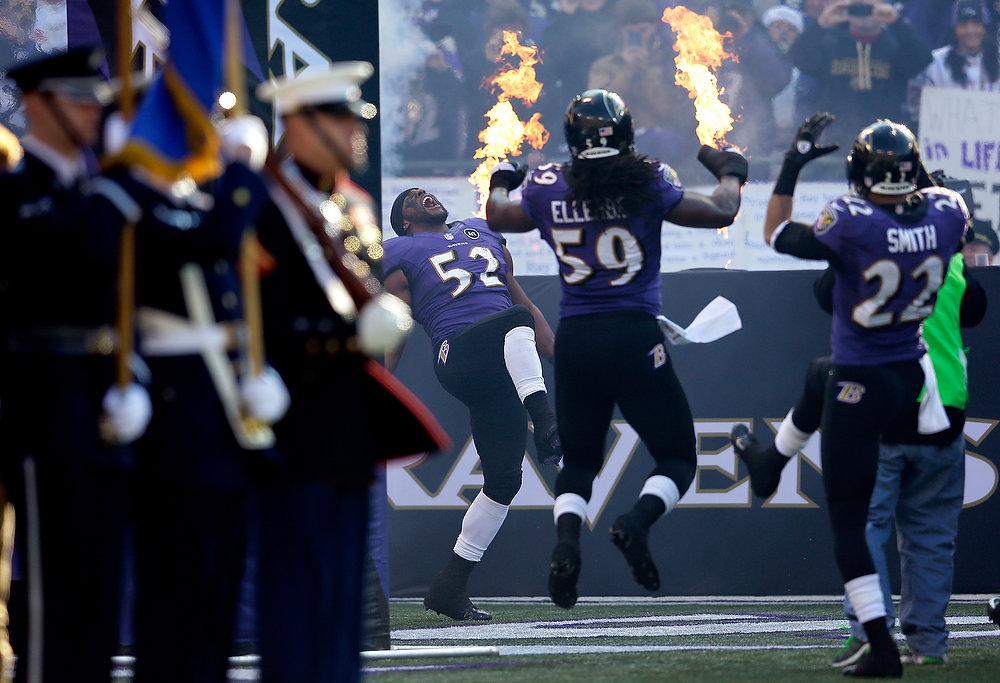 . Ray Lewis #52 of the Baltimore Ravens takes the field with teammates Dannell Ellerbe #59 and Jimmy Smith #22 against the Indianapolis Colts during the AFC Wild Card Playoff Game at M&T Bank Stadium on January 6, 2013 in Baltimore, Maryland.  (Photo by Rob Carr/Getty Images)