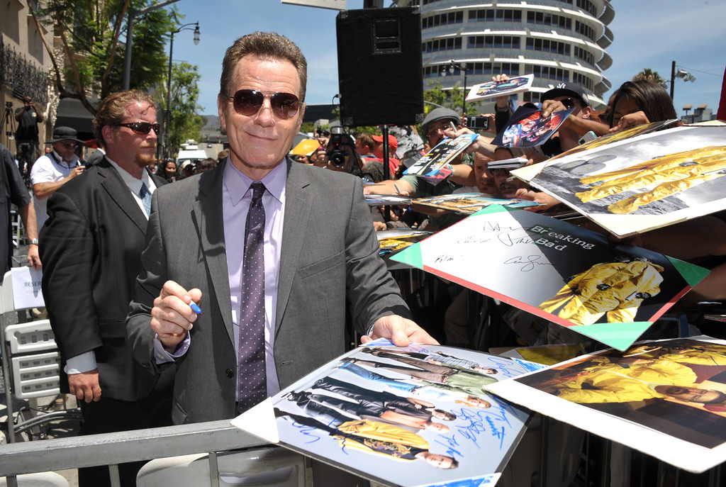. Bryan Cranston signs autographs after receiving a star on the Hollywood Walk of Fame on Tuesday, July 16, 2013 in Los Angeles. (Photo by John Shearer/Invision for AMC/AP Images)