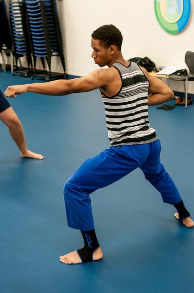 Student Jamon Schmidt in stance at karate class in Dugan Wellness Center