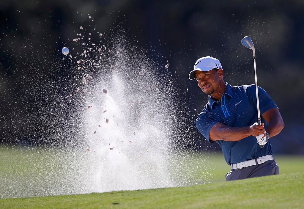 . Tiger Woods of the U.S. hits from a sand trap on the 17th green during third round play in the 2013 Masters golf tournament at the Augusta National Golf Club in Augusta, Georgia, April 13, 2013.   REUTERS/Brian Snyder