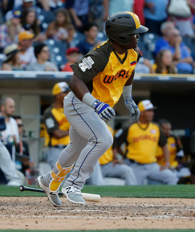 . World Team\'s Dilson Herrera, of the New York Mets, follows through on an RBI base hit during the ninth inning of the All-Star Futures baseball game, Sunday, July 10, 2016, in San Diego. (AP Photo/Lenny Ignelzi)