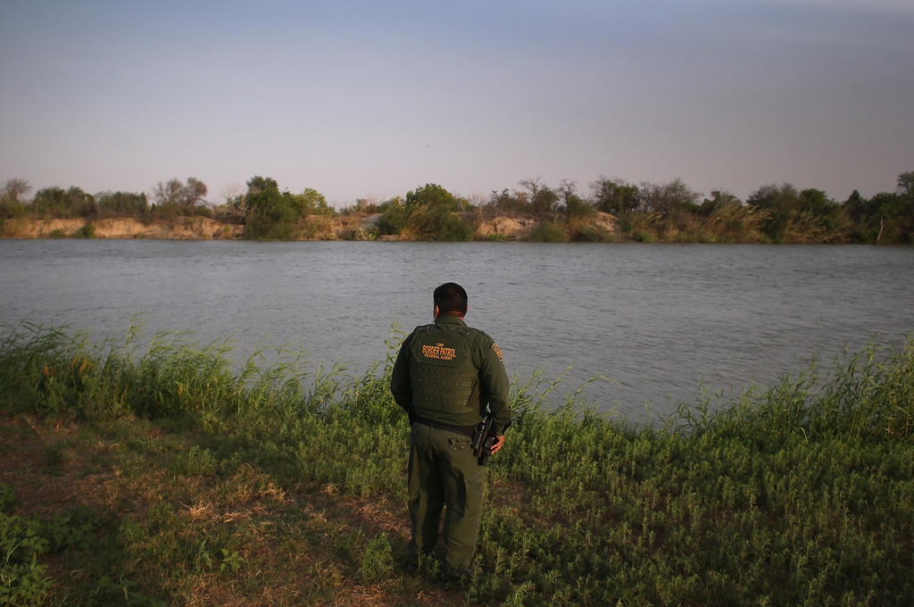 . MCALLEN, TX - APRIL 10:  U.S. Border Patrol agent Sal De Leon looks across the Rio Grande River into Mexico at the U.S.-Mexico border while on patrol on April 10, 2013 in McAllen, Texas. According to the Border Patrol, undocumented immigrant crossings have increased more than 50 percent in Texas\' Rio Grande Valley sector in the last year. Border Patrol agents say they have also seen an additional surge in immigrant traffic since immigration reform negotiations began this year in Washington D.C. Proposed refoms could provide a path to citizenship for many of the estimated 11 million undocumented workers living in the United States.  (Photo by John Moore/Getty Images)