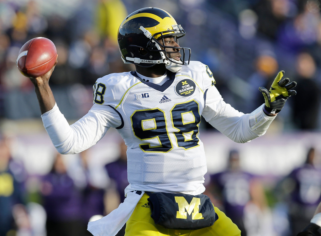 . Michigan quarterback Devin Gardner (98) looks to a pass against Northwestern during the first half of an NCAA college football game in Evanston, Ill., Saturday, Nov. 8, 2014. (AP Photo/Nam Y. Huh)