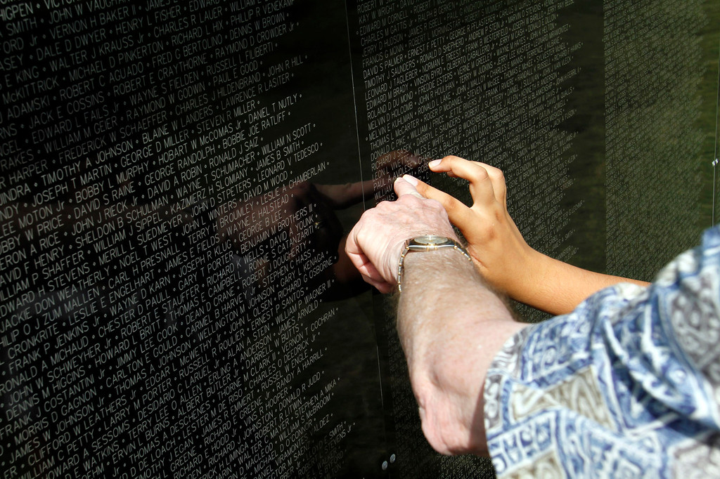 ". Families look for names of relatives on the Vietnam Veterans Memorial, during the Vietnam Veterans Memorial ""The Wall That Heals\"" Closing Ceremony event, at La Habra High School, in La Habra, Sunday, July 14, 2013. (SGVN/Correspondent Photo by James Carbone)"