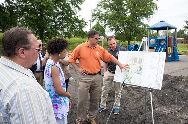06/05/19 Wesley Bunnell | Staff New Britain Parks Director Erik Barbieri points out some of the planned renovations to Chesley Park before the official ground breaking ceremony on Wednesday afternoon.