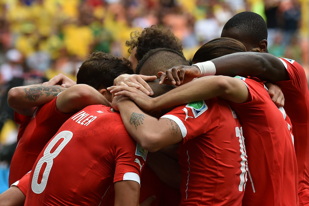 . Switzerland\'s players celebrate after scoring a goal during the Group E football match between Honduras and Switzerland at the Amazonia Arena in Manaus during the 2014 FIFA World Cup on June 25, 2014. RODRIGO ARANGUA/AFP/Getty Images