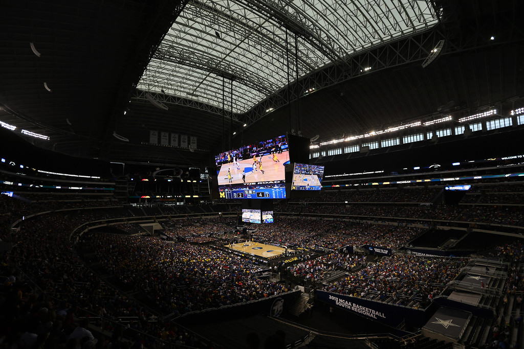 . Cowboys Stadium is seen during the first half of a regional semifinal game between Kansas and Michigan in the NCAA college basketball tournament, Friday, March 29, 2013, in Arlington, Texas. (AP Photo/Tim Donnelly)