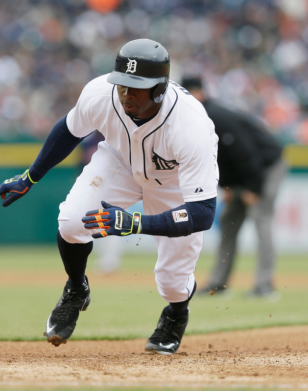 . Detroit Tigers\' Rajai Davis jumps back to first during the second inning of an opening day baseball game against the Minnesota Twins in Detroit, Monday, April 6, 2015. (AP Photo/Carlos Osorio)
