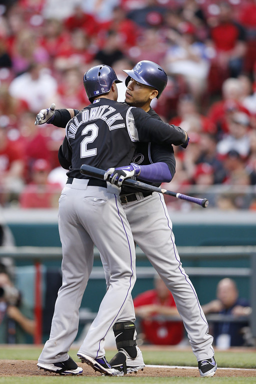 . CINCINNATI, OH - MAY 9: Troy Tulowitzki #2 of the Colorado Rockies is congratulated by Carlos Gonzalez #5 after hitting a home run in the top of the fourth inning of the game against the Cincinnati Reds at Great American Ball Park on May 9, 2014 in Cincinnati, Ohio. (Photo by Joe Robbins/Getty Images)
