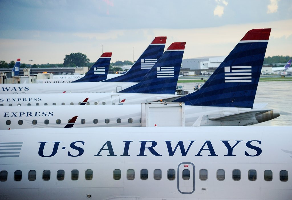 """. <p>9. US AIRWAYS <p>Unlike some airlines, doesn�t charge extra fee for pornographic tweets. (unranked) <p><b><a href=\'http://www.usatoday.com/story/news/nation-now/2014/04/15/worst-company-tweets-mistakes/7729189/\' target=\""""_blank\""""> HUH?</a></b> <p>    (Kevork Djansezian/Getty Images)"""