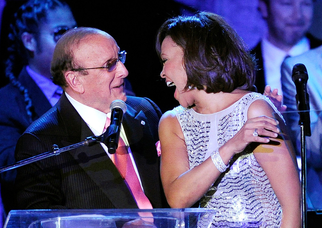 . Producer Clive Davis shares a moment with singer Whitney Houston performs at the pre-Grammy gala & salute to industry icons with Clive Davis honoring David Geffen, Sunday, Feb. 13, 2011, in Beverly Hills, Calif. (AP Photo/Mark J. Terrill)