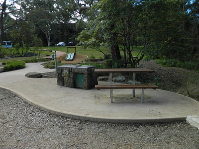 bbq table and bench and bbq and musical element and slide on mound
