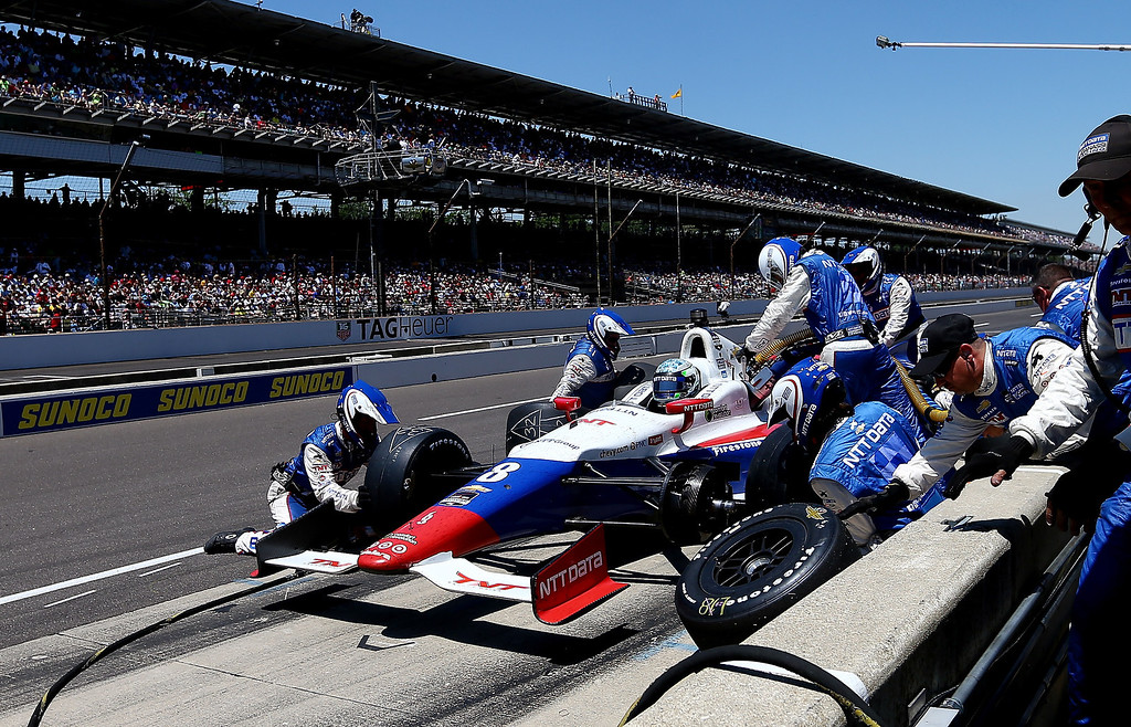 . Ryan Briscoe of Austraila, driver of the #8 NTT Data Chip Ganassi Racing Chevrolet Dallara, pits during the 98th running of the Indianapolis 500 at Indianapolis Motorspeedway on May 25, 2014 in Indianapolis, Indiana.  (Photo by Jonathan Ferrey/Getty Images)