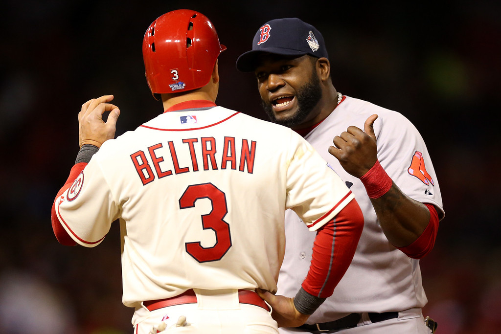 . ST LOUIS, MO - OCTOBER 26:  David Ortiz #34 of the Boston Red Sox talks to Carlos Beltran #3 of the St. Louis Cardinals in the seventh inning of Game Three of the 2013 World Series at Busch Stadium on October 26, 2013 in St Louis, Missouri.  (Photo by Ronald Martinez/Getty Images)