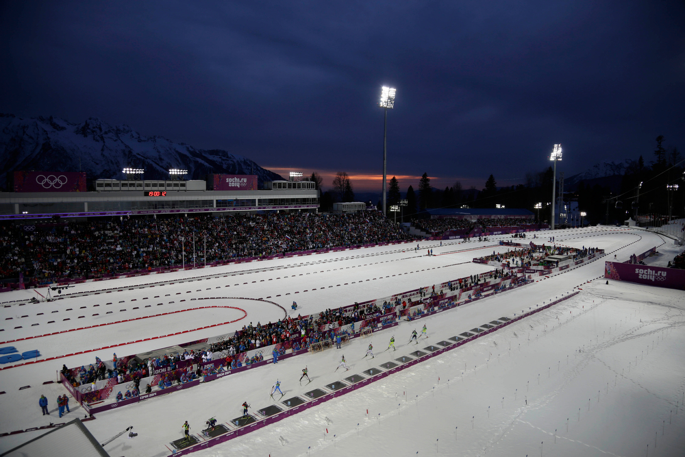 . Competitors take their positions in the shooting range during the men\'s biathlon 4x7.5K relay at the 2014 Winter Olympics, Saturday, Feb. 22, 2014, in Krasnaya Polyana, Russia. (AP Photo/Felipe Dana)