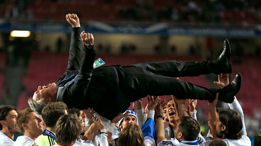 . Real\'s coach Carlo Ancelotti, is lifted in the air, after his team won the Champions League final soccer match between Atletico Madrid and Real Madrid in Lisbon, Portugal, Saturday, May 24, 2014.  (AP Photo/Andres Kudacki, File)