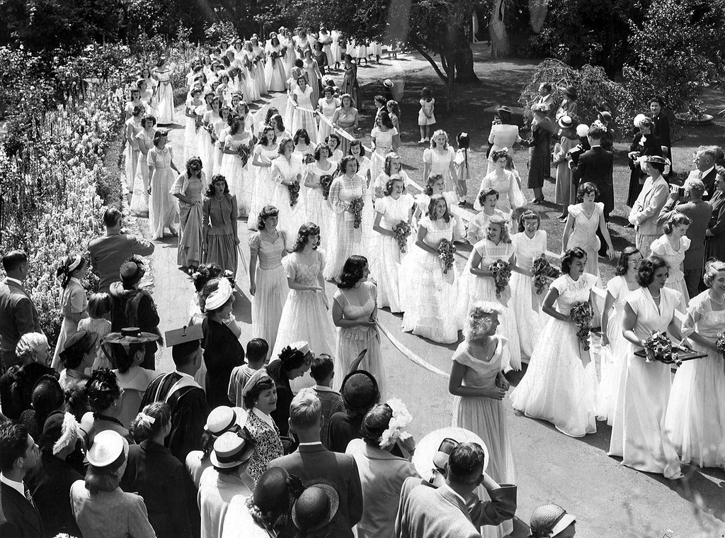 . The processional from the chapel to Channing Hall at Anna Head School in Berkeley, Calif. is a traditional ceremony on graduation day which was observed for the sixtieth time on Friday June 4, 1948. Fifty- nine seniors in their white dresses, carrying bouquets of red roses, received their sheepskins at formal exercises. (Oakland Tribune Archives)