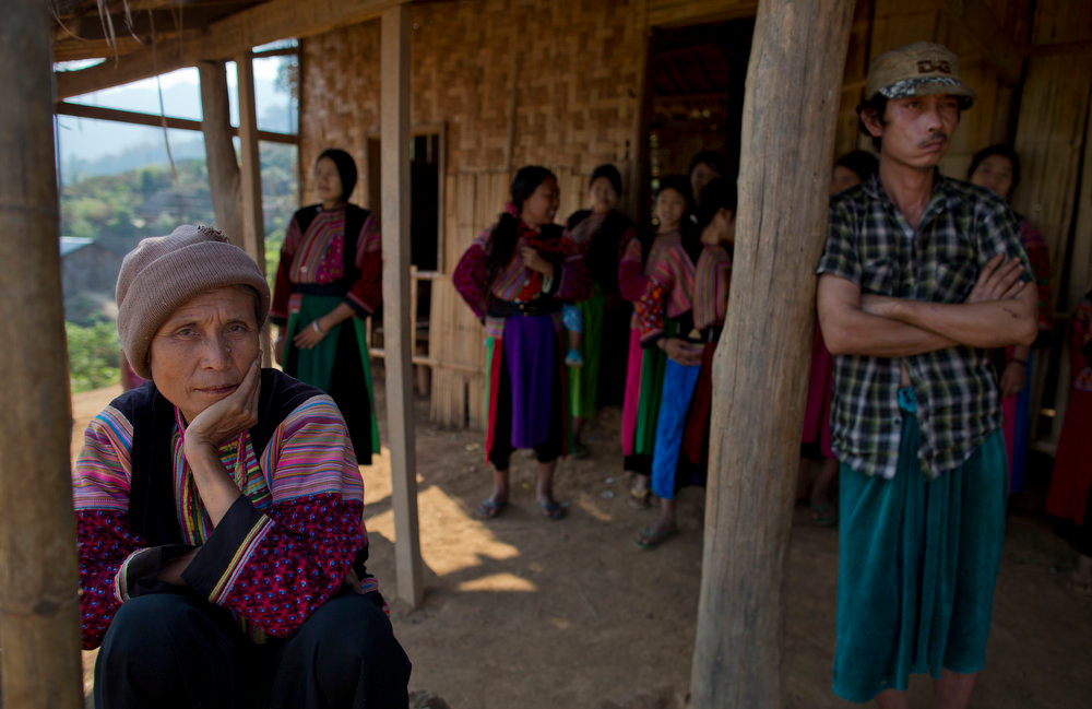 . Ethnic Lisu children and women in traditional clothing gather outside the Ywar Thar Yar village\'s school, central Shan state, Myanmar on A vehicle travels down the dusty road leading to an ethnic Lisu village Ywar Thar Yar, central Shan state, Myanmar on Feb 21, 2013. Far from Myanmar\'s postcard-perfect pagodas and colonial relics, the remote mountain villages of southern Shan State do not appear on maps of Myanmar or in any guide books. In obscurity, they have been ground zero for Myanmar\'s drug trade which has thrived on poverty and corruption. Far from Myanmar\'s postcard-perfect pagodas and colonial relics, the remote mountain villages of southern Shan State do not appear on maps of Myanmar or in any guide books. In obscurity, they have been ground zero for Myanmar\'s drug trade which has thrived on poverty and corruption. (AP Photo/Gemunu Amarasinghe)