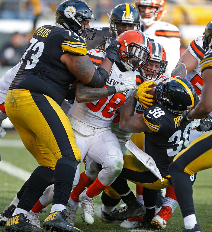 . Pittsburgh Steelers running back Stevan Ridley (38) backs into the end zone for a touchdown during the first half of an NFL football game in Pittsburgh, Sunday, Dec. 31, 2017. (AP Photo/Keith Srakocic)