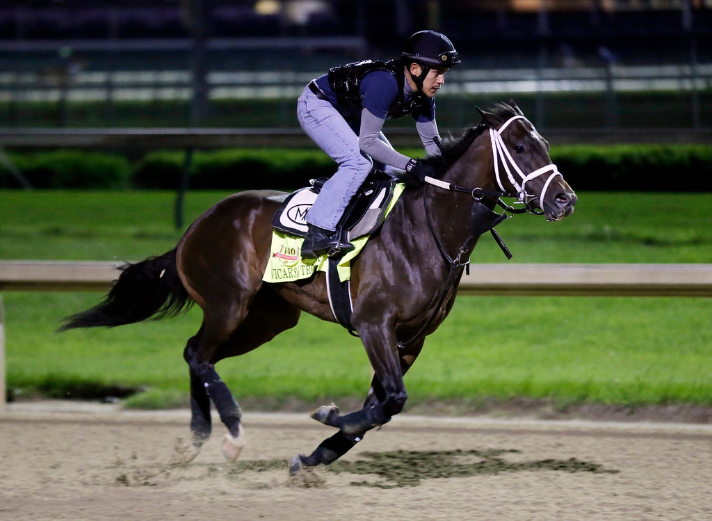. Exercise rider Joel Barrientos takes Kentucky Derby entrant Vicar\'s in Trouble for a morning workout at Churchill Downs Thursday, May 1, 2014, in Louisville, Ky. (AP Photo/Charlie Riedel)