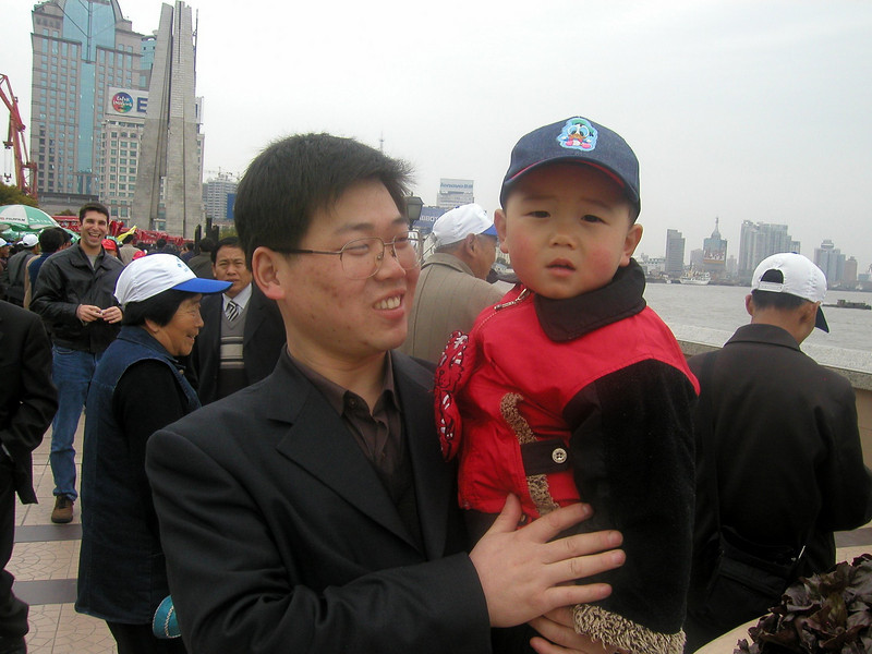 Father and Son walking along the Bund, March 2004 Shanghai Atmosphere