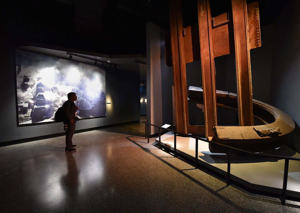 . A photograph of the World Trade Center after the September 11, 2001 attacks (L) and  a column and facade segment (R) seen during a press preview of the National September 11 Memorial Museum at the World Trade Center site May 14, 2014 in New York. AFP PHOTO/Stan HONDA/AFP/Getty Images