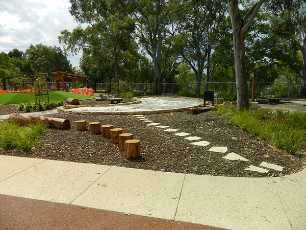 log round steppers and tree trunk log for balancing and stepping stones in mulch and sandpit
