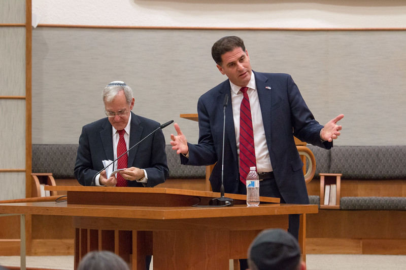 Larry Sidman considers the next question card from audience-submitted questions, while the Ambassador answers -- Ron Dermer, Israeli Ambassador to the United States spoke at Congregation Beth El (Bethesda, MD) on October 17, 2017.