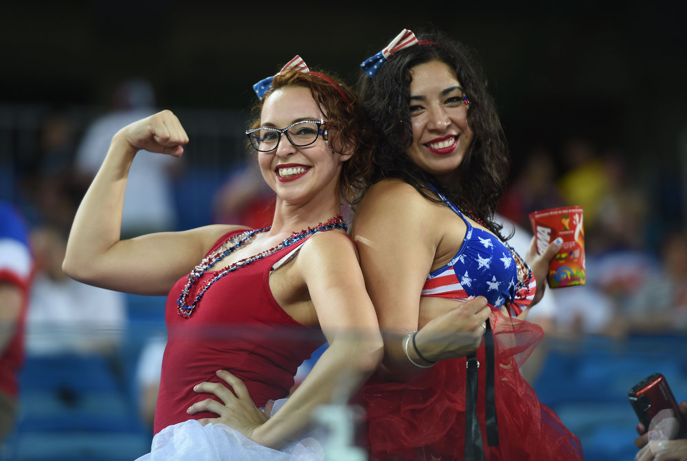 Description of . US fans cheer before a Group G football match between Ghana and US at the Dunas Arena in Natal during the 2014 FIFA World Cup on June 16, 2014.  JAVIER SORIANO/AFP/Getty Images
